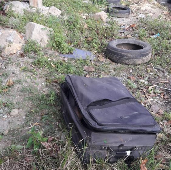 Mala com o corpo estava na entrada do Morro do Mosquito - Divulgação/ND