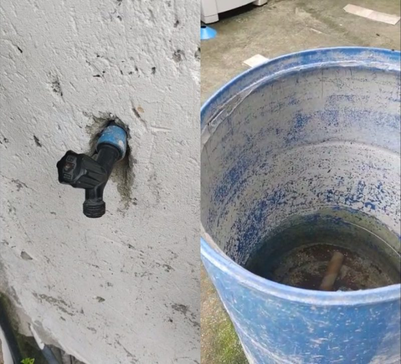 Torneira e um reservatório de água da chuva